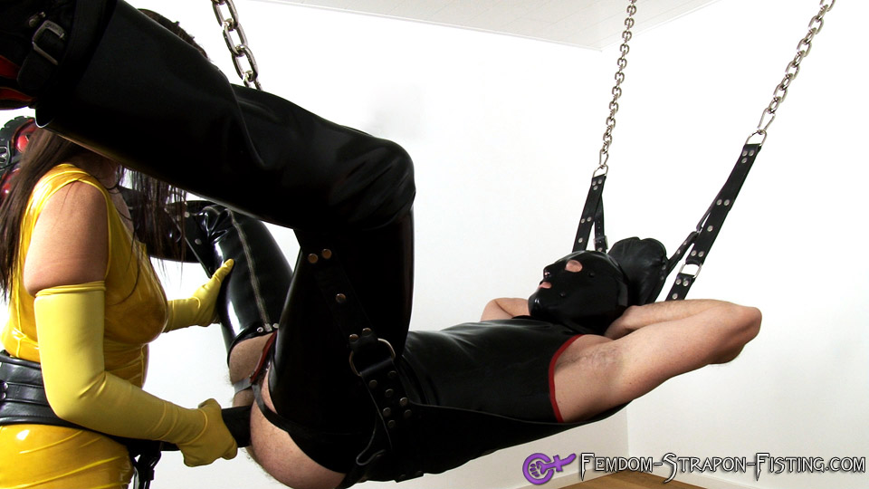 Latex Mistress with huge strapon fucks male slave
