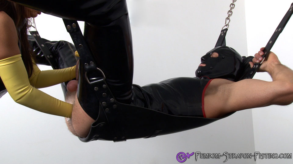 Femdom fists man while giving him a handjob