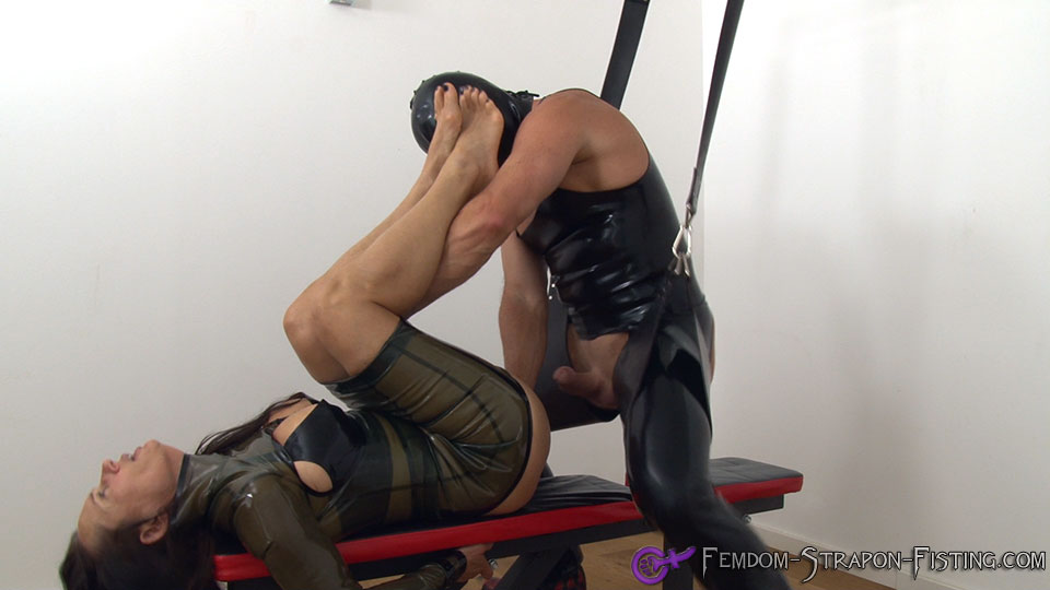 Dominatrix allows her slave to fistfuck her pussy